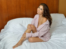 Sexy biracial female model - posing in men's shirt Stock Image