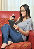 Sexy biracial woman drinking wine and reading Royalty Free Stock Photography