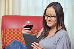 Sexy biracial woman drinking wine and reading Royalty Free Stock Photos
