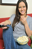 Sexy biracial woman eating popcorn Stock Photography
