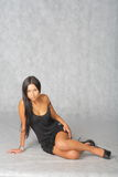 black dress. Brunette in studio with a lot of copyspace Stock Images