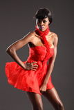 Sexy black fashion model in short red dress Royalty Free Stock Photos