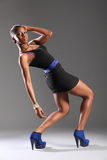 Sexy black fashion model strikes pose in studio Stock Photo