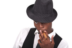 Sexy black man wearing a hat and smoking a cigar Royalty Free Stock Images