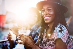 Sexy Black Woman Drinking Cocktail In Summer And Enjoying Her Vacation Royalty Free Stock Photo