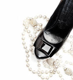 Sexy black woman shoe and pearl necklace Royalty Free Stock Photos