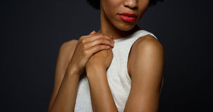 Sexy black woman standing in a white gown. Cropped portrait of Sexy black woman standing in a white gown Stock Images