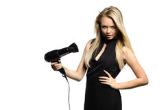 Sexy blond in black dress with hairdryer Royalty Free Stock Photography