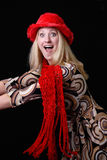 Sexy Blond in Christmas Hat and Scarf. A beautiful young blonde woman looks happy and surprised. She is wearing her red christmas scarf and hat Stock Images
