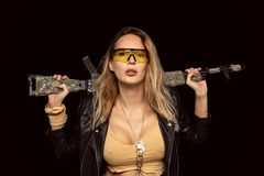 blond dangerous woman with automatic rifle royalty free stock photos