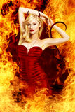 Sexy blond devil Royalty Free Stock Photos