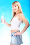Sexy blond drink water from bottle Royalty Free Stock Photo