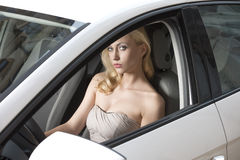 Sexy blond driving Stock Image