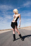 Sexy blond fashion girl on the road Stock Photo