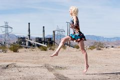 Sexy blond fashion girl running Stock Images