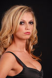 Sexy blond female in black top Stock Photography