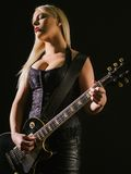 blond female playing electric guitar Royalty Free Stock Photography