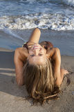 Blond girl. Posing on a beach royalty free stock photo