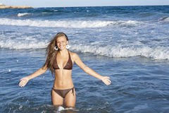 Blond girl. Posing on a beach royalty free stock images
