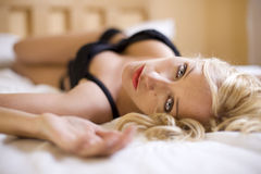 Sexy blond girl on the bed Stock Photo