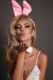 Sexy blond girl with bunny ears head accessory, symbol of Easter holiday Royalty Free Stock Photo