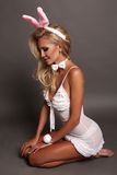 Sexy blond girl with bunny ears head accessory, symbol of Easter holiday Stock Images