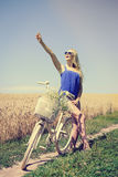 blond girl excited near white bike in summer Royalty Free Stock Photos
