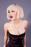 Sexy blond girl with necklace Royalty Free Stock Photography