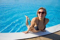 Sexy blond girl posing at the pool Stock Photo