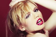 Sexy blond girl on red background Stock Images