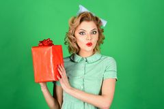 Sexy blond girl with retro makeup hold present box. royalty free stock photography