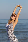 blond girl in short dress outdoors Royalty Free Stock Photography