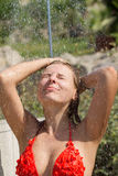 Sexy blond girl showering outdoors Royalty Free Stock Images