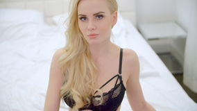 Sexy Blond Girl Sitting on Bed stock video footage