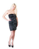 Sexy blond lady in black dress against white Stock Photos