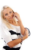 Sexy blond lady calling by phone Royalty Free Stock Image