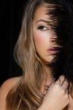 Sexy blond lady. Sexy blond woman posing on dark background Stock Image