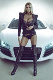 Sexy blond model in lingerie with car Stock Image