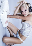 blond model Listens to music Royalty Free Stock Images