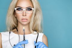 Sexy blond nurse in glasses, holding a stethoscope Stock Photo
