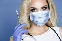 Sexy blond nurse in glasses, holding a stethoscope Stock Images