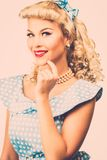 Sexy blond pin up style woman Royalty Free Stock Image