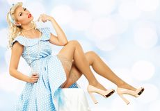 Sexy blond pin up young woman Royalty Free Stock Image