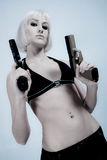 Sexy blond with pistols Stock Images
