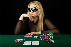 Sexy Blond Playing Poker Royalty Free Stock Photography