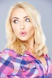 Sexy blond pouting her lips in admiration Stock Images