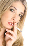 Sexy blond smoking Stock Images