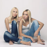 Sexy blond twins couple Stock Photo