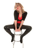 Sexy blond woman. Sitting on a bar chair Royalty Free Stock Image