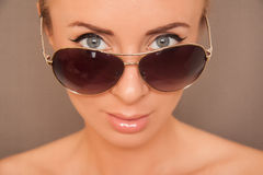 Sexy blond woman in aviators. Blond caucasian woman in aviator sunglasses Royalty Free Stock Images